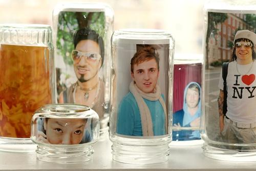 http://content.photojojo.com/diy/glass-jar-photo-frames/